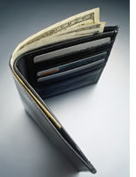 Wallet with some bills sticking out